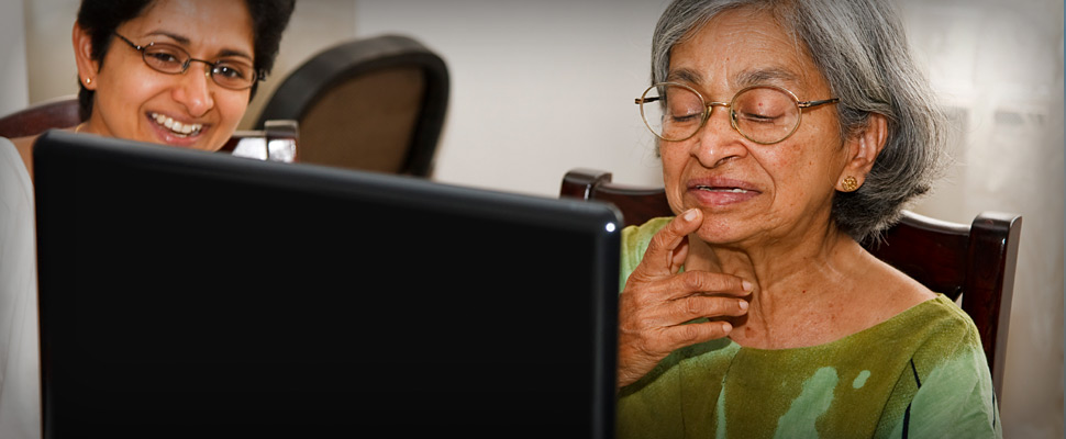 Elderly lady working on a computer
